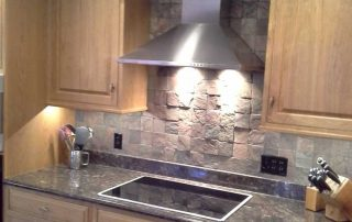 kitchen with natural wood cabinets & stone backsplash